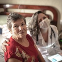 Senior and nurse wearing a mask